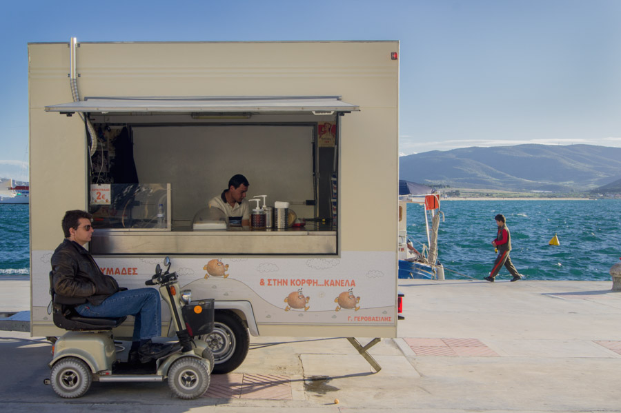 Men and donuts trailer in Volos, Greece, 2012. Photo by Ilias Antoniou.