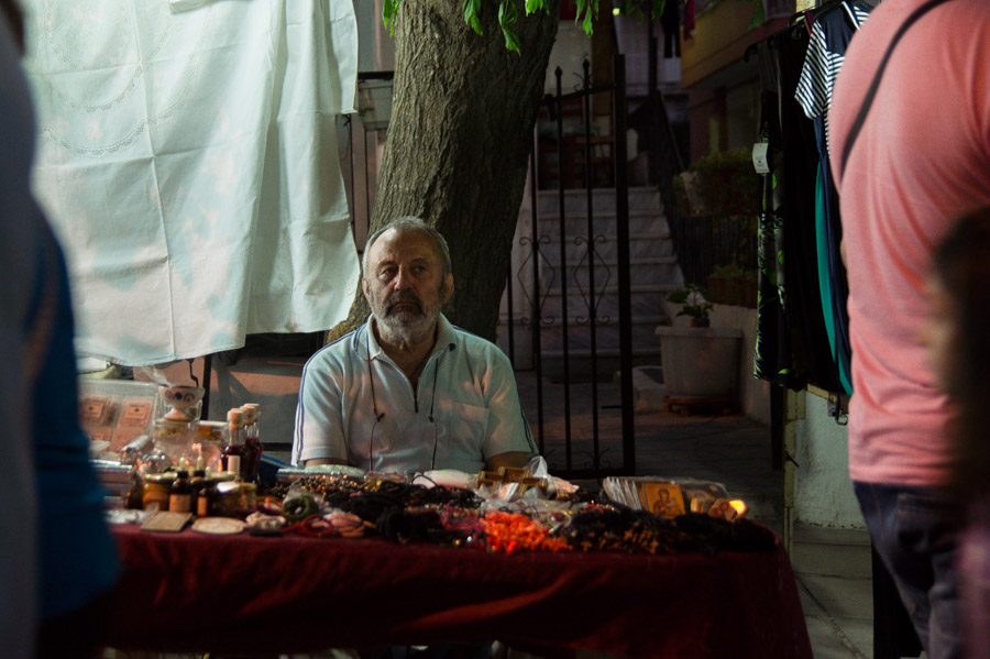 Man selling jewelery  at street fair in Thessaloniki. Photo by Ilias Antoniou.