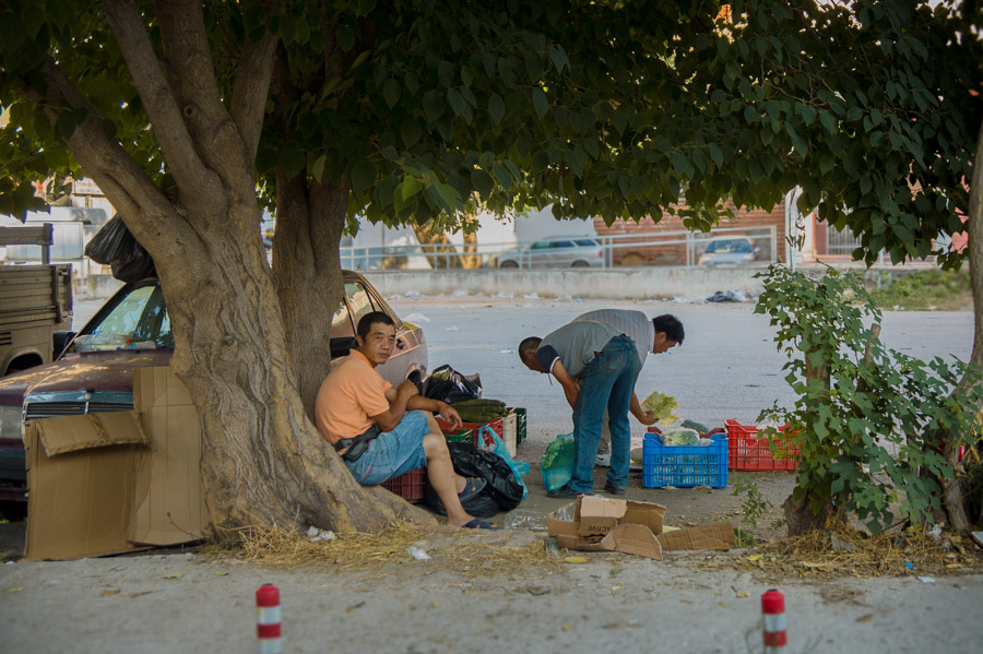 Asian men carrying fruit, Thessaloniki, GR, 2013. Photo by Ilias Antoniou.
