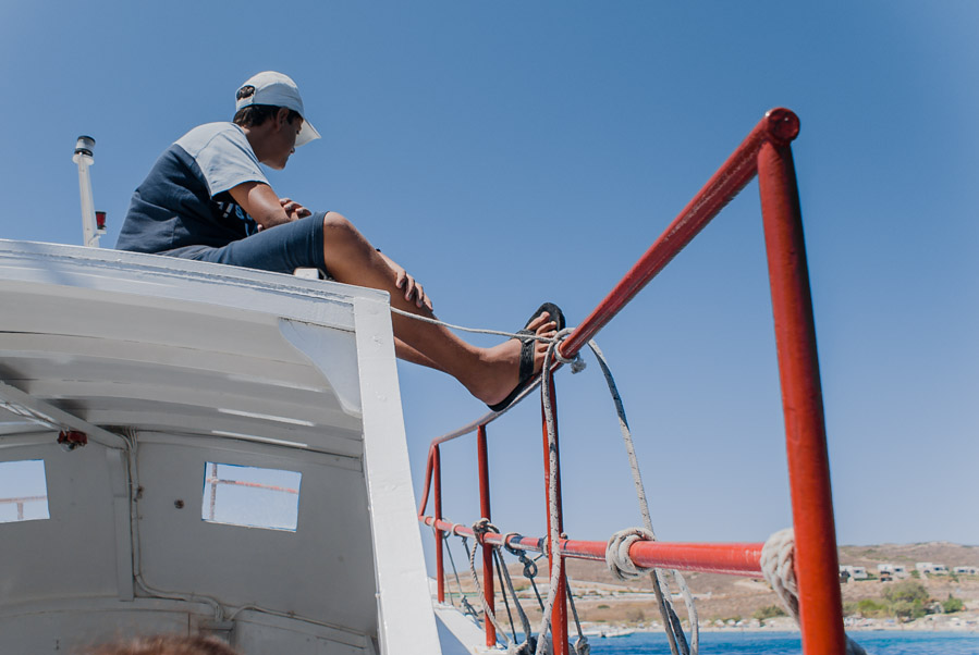 Boy on boat at Paros island, Greece, 2009. Photo by Ilias Antoniou.