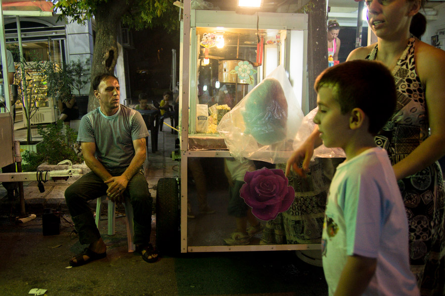 Man looking at boy  at street fair in Thessaloniki. Photo by Ilias Antoniou.