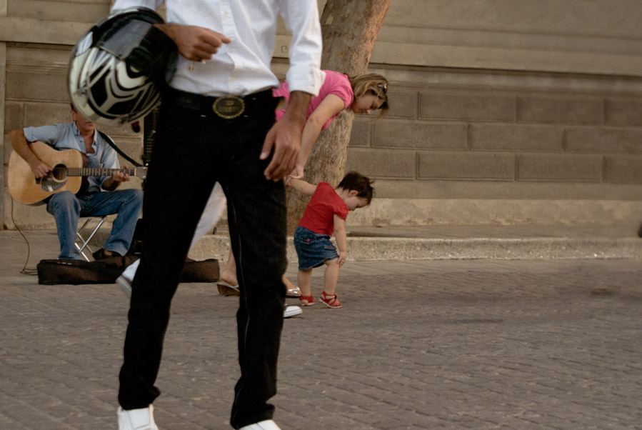Man with guitar, man with suit and a child, Athens, Greece, 2009. Photo by Ilias Antoniou.