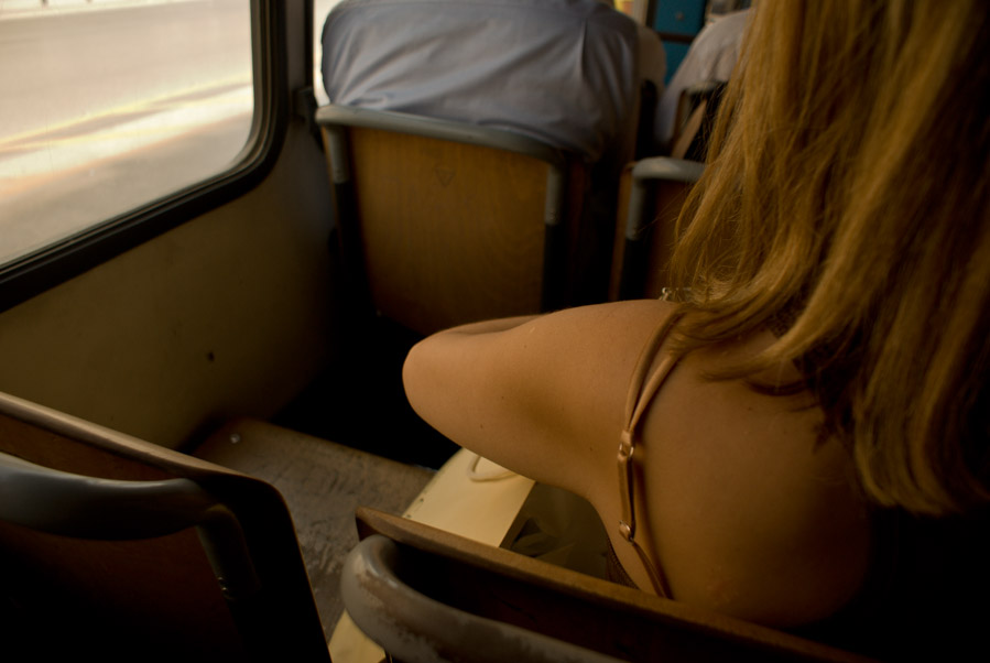 Girl sitting in bus next to empty seat, Thessaloniki, GR, 2009. Photo by Ilias Antoniou.