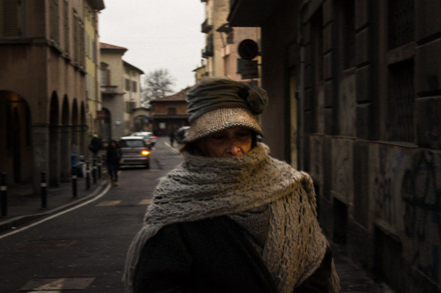Old lady walking down street in Bergamo, Italy, 2013