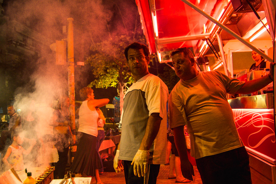 Men and meat barbeque at street fair in Thessaloniki. Photo by Ilias Antoniou.