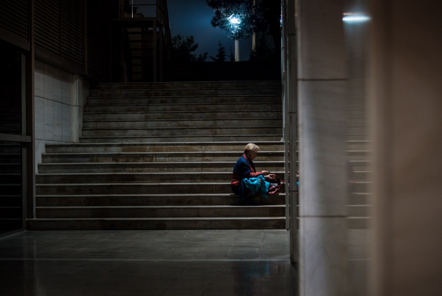 Lady sitting alone on stairs, Thessaloniki, Greece, 2010. Photo by Ilias Antoniou.