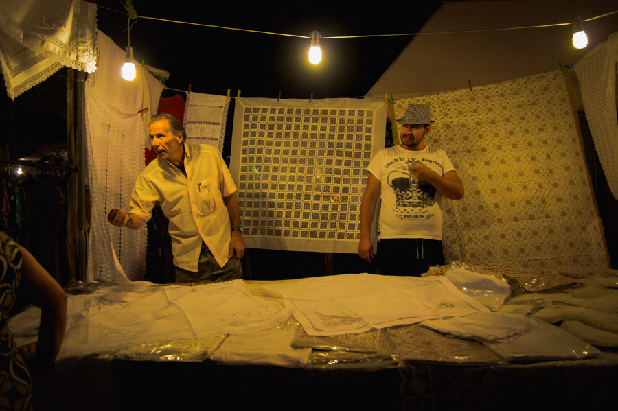 Men selling fabrics at street fair in Thessaloniki. Photo by Ilias Antoniou.