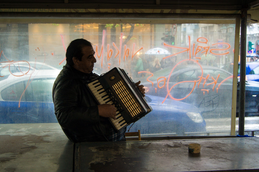 Man with accordion in street of Thessaloniki, Greece, 2012. Photo by Ilias Antoniou.
