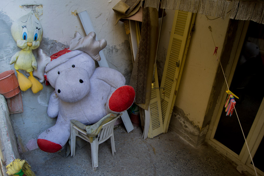 Abandoned plush toys outside house in Theesaloniki Greece, 2012. Photo by Ilias Antoniou.