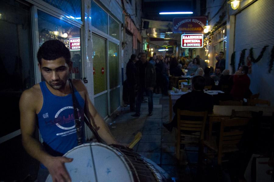 Man carrying a large drum on new year's eve at Thessaloniki, 2013. Photo by Ilias Antoniou