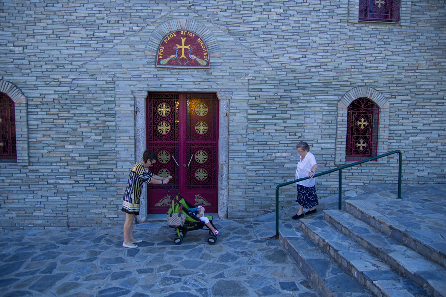 Women and baby in front of church, Street photography by Ilias Antoniou.