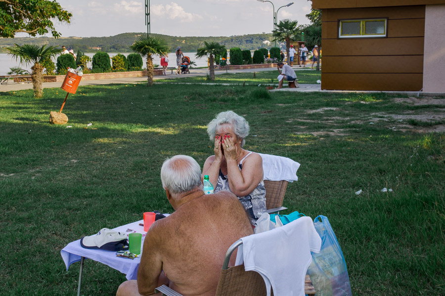 Old couple relaxing near lake, photo by Ilias Antoniou, 2014